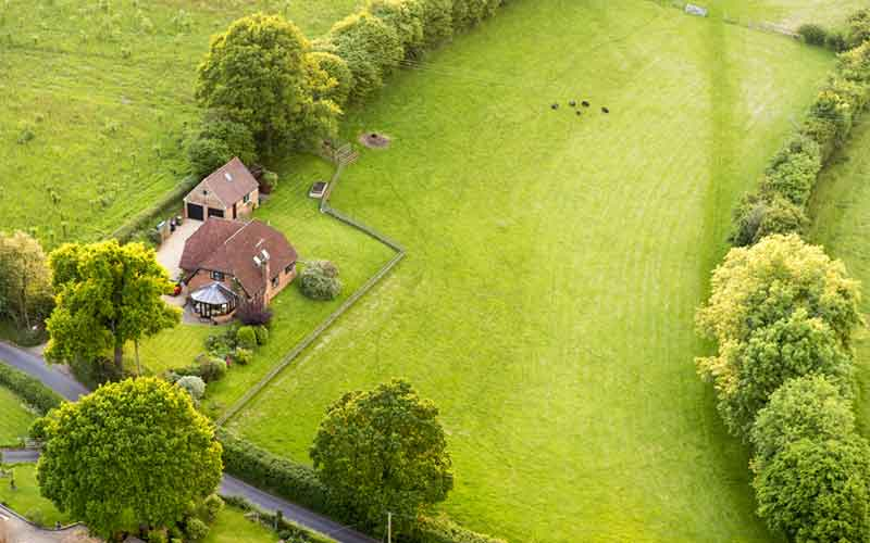 Aerial view of a farmhouse in the countryside